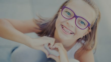 smiing girl with braces